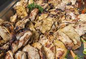 picture of buffet  - Grilled chicken pieces on display at an oriental restaurant buffet - JPG