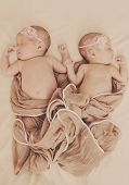 picture of identical twin girls  - two lovely newborn twin s are sleeping - JPG