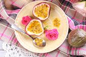 foto of passion fruit  - Passion fruit on plate on color napkin background - JPG