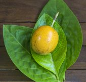 foto of passion fruit  - Passion fruits and Green Leaf on Wooden Background - JPG