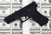 picture of 100 dollars dollar bill american paper money cash stack  - Handgun on one hundred dollar bills background - JPG