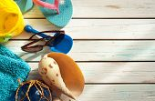 picture of spade  - Beach items including towel sunglasses and bucket and spade over wood panels - JPG