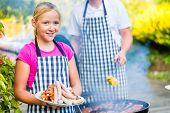 pic of bbq food  - Family having barbecue food on grill at family garden BBQ  - JPG