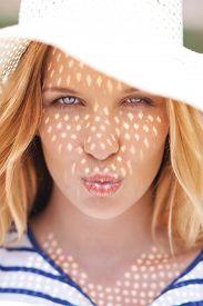 image of flirty  - Flirty girl giving air kiss - JPG