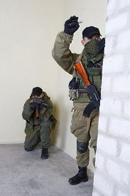 foto of ak-47  - insurgents with AK 47 throws a grenade inside the building - JPG