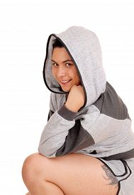 foto of hoodie  - A beautiful young woman in a portrait picture in a gray hoodie isolated