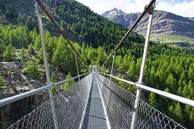 pic of suspension  - The mountain landscape with suspension bridge - JPG