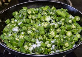 pic of okra  - Okra being cooked in the pan on the gas stove - JPG