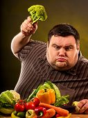 Diet fat man eating healthy food. Health breakfast with vegetables broccoli for overweight person. M poster