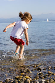 pic of children beach  - little cute girl playing at the beach.