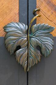 stock photo of door-handle  - door handle made as a grape leaf - JPG