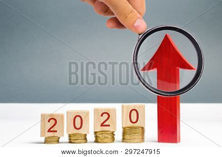 poster of Wooden Blocks 2020 And Red Arrow Up. Concept Of Business And Finance. Planning. Investing In The Fut