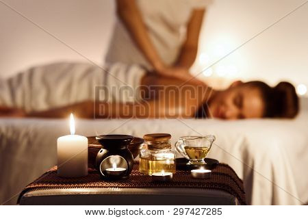 poster of Aroma Spa. Woman Enjoying Massage In Luxury Spa With Candle On Foreground