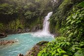 Majestic waterfall in the rainforest jungle of Costa Rica. Tropical hike. poster