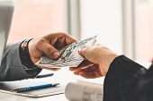 Businessman Hand Sending Money To Another Business Person. Transaction, Payment, Salary And Banking  poster