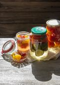 Fermented Preserved Vegetables In Jar On Wooden Table. Copyspace. poster