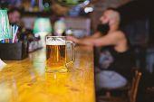 Beer Mug On Bar Counter Defocused Background. Glass With Fresh Lager Draft Beer With Foam. Mug Fille poster