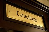 Golden concierge sign in a luxury hotel