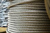 Clean New Steel Cable, Steel Wire Or Steel Rope Wound On A Bobbin Standing On A Shelf poster