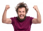 Happy winner. Crazy bearded Man with funny Haircut celebrating his success. Guy make victory gesture poster