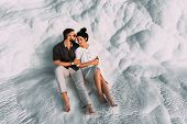 Loving Couple In The Arms. Man And Woman Hugging On White Background. Stylish Couple In Love. Newly  poster
