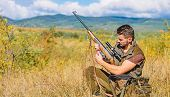 Hunting Shooting Trophy. Hunter With Rifle Looking For Animal. Hunting Hobby And Leisure. Man Chargi poster