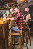 Friends Relaxing In Pub. Order Drinks At Bar Counter. Hipster Brutal Bearded Man Spend Leisure With  poster