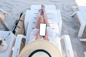 Top View Mockup Image Of A Woman Holding White Mobile Phone With Blank Desktop Screen While Laying D poster