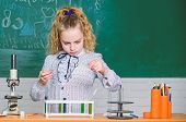 Little Kid Learning Chemistry In Lab. Happy Children. Chemistry Lesson. Students Do Biology Experime poster