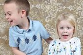 Adorable little brother and Sister having fun on studio background
