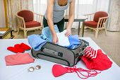 Woman Arriving In Hotel Room On Vacation. Traveler Lifestyle. poster