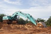 image of heavy equipment operator  - Heavy Duty Construction Equipment Parked in Thailand - JPG