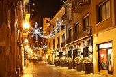 ALBA - DECEMBER 07: Popular touristic street in historic center of Alba with opened shops, bars and