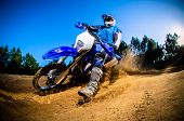 stock photo of dirt-bike  - Enduro bike rider on action - JPG