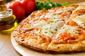 image of basil leaves  - A freshly baked traditional Pizza Margherita with tomatoes - JPG