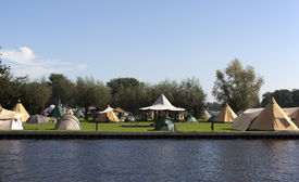 picture of tipi  - tipi tents on a dutch camping with blue sky - JPG