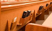 picture of pews  - Holy Bible in the back of a pew in a sanctuary  - JPG