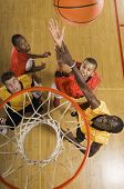 stock photo of slam  - High angle view of basketball player attempting to slam dunk ball - JPG