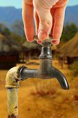 stock photo of water shortage  - old rusty water tap in africa village