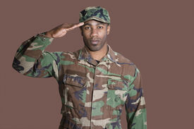 pic of united states marine corps  - Portrait of a young African American US Marine Corps soldier saluting over brown background - JPG