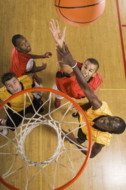 picture of slam  - High angle view of basketball player attempting to slam dunk ball - JPG