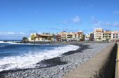 picture of tourist-spot  - Tourists at the pebble beach in the village La Playa on 19 January 2014 - JPG