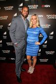 LOS ANGELES - FEB 11:  Hank Baskett, Kendra Wilkinson at the