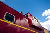 picture of caboose  - Detail of a shiny red train caboose - JPG