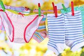 pic of wet pants  - Baby clothes hanging on clothesline - JPG