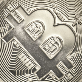 image of bit coin  - Bit coin currency symbol closeup financial concept - JPG