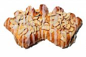 stock photo of claw  - a Hot from the oven Fresh Baked Bear Claw Pastry covered in slivered Almonds and Sugar Frosting isolated on white with room for your text - JPG