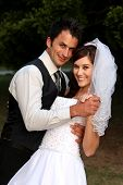 pic of wedding couple  - Beautiful wedding couple dancing on the lawn at their reception - JPG