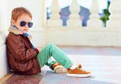 image of bomber jacket  - cute stylish boy in leather jacket and gum shoes - JPG