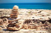 stock photo of fulcrum  - Stones balance pebbles stack over blue sea - JPG